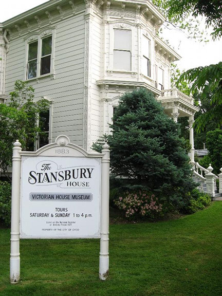 Photo of the old Stansbury House located in Oroville California. Sign states that tours are on Sat. & Sun. 1pm to 4 pm.